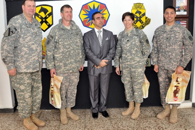 [From left to right] Col. Larry Phelps, commander of the 15th Sustainment Brigade, 13th Sustainment Command (Expeditionary), and Greenville, Ala., native; Brig. Gen. Paul Wentz, commander of the 13th ESC out of Fort Hood, Texas; Yayah Sami Jamil, a civilian contractor in charge of life support, reception, and food; Lt. Col. Paula Lodi, commander of the 15th Special Troops Battalion, 15th Sust. Bde., and Franklin, Mass., native; and Capt. Estan Davis, the commander of Headquarters and Headquarters Company, 15th STB, and Waterford, Va., native, pose for a photo here Jan. 21. (U.S. Army photo by Sgt. Matthew C. Cooley, 15th Sustainment Brigade public affairs)
