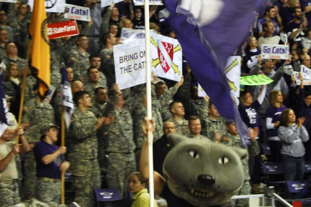 Soldiers serving with the 1st Battalion, 7th Field Artillery Regiment wildly cheer for the Kansas State University men's basketball team during the ESPN GameDay celebration at Bramlage Coliseum Jan. 30.