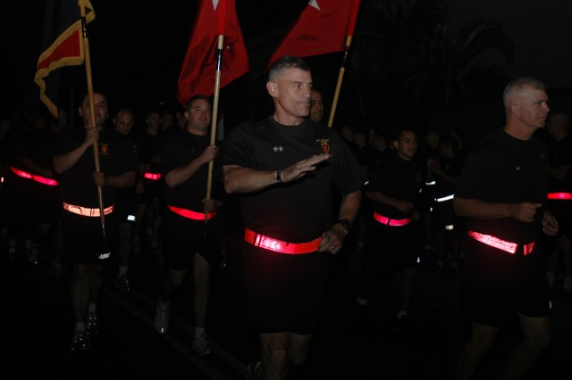 Maj. Gen. Robert L. Caslen Jr., commanding general, 25th Infantry Division, leads the annual division run during the early morning hours at Schofield Barracks, Hawaii, Jan. 29. This year's run marks the first occasion in which Caslen has been able to participate in a group event with the majority of the brigades and battalions (U.S. Army photo by Spc. Mahlet Tesfaye, 25th Infantry Division Public Affairs Office).