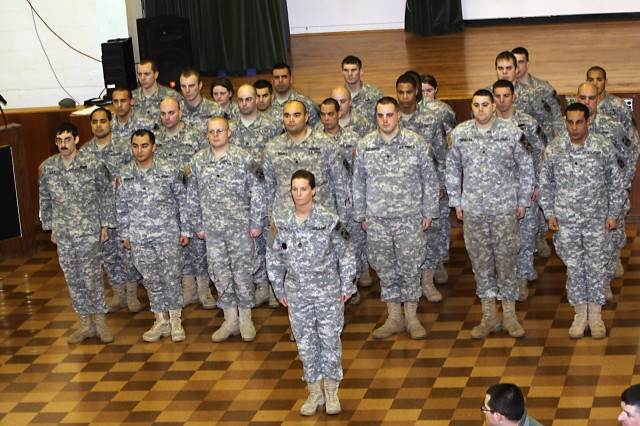 Sgt 1st Class Maureen Meehan, 2nd Platoon Sgt, 49th Missile Defense Bn., and her platoon of Military Police Officers, stand at attention prior to the beginning of the NCO Induction Ceremony on Jan. 25.
