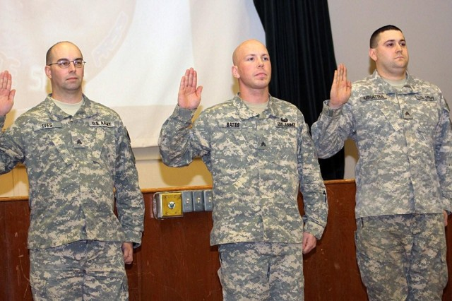 (Left to Right) Newly inducted Sergeants Gabriel Ives,  James Bates, and Christopher Minatra take the Oath of the NCO during their induction into the corps of the non commissioned officer on Fort Greely, Alaska. These Sergeants represent the military police officers who secure and defend the Missile Defense Complex 24 hours a day, seven days a week.