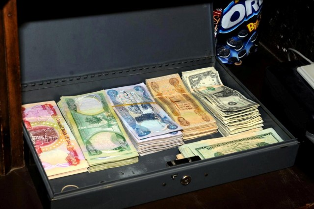 The contents of the cash drawer Jan. 27 at the finance office at Contingency Operating Location Basra, Iraq, illustrates how the use of U.S. currency is being reduced in Iraq.