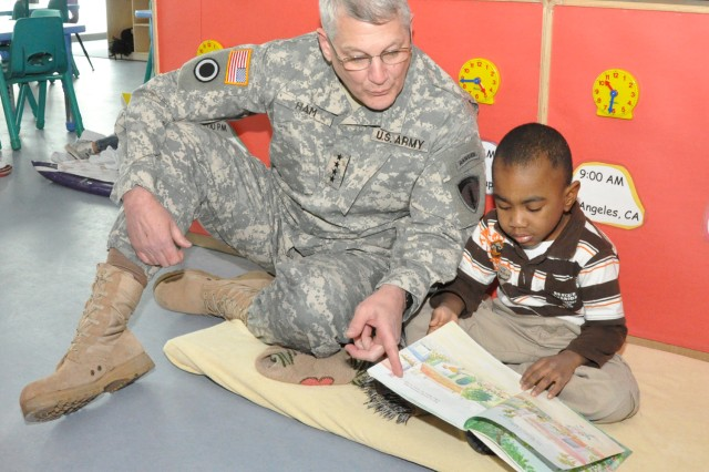 Gen. Carter Ham, U.S. Army Army Europe commander, enjoys a reading session with Tyreek Karim during a visit to the Wiesbaden Army Airfield Child Development Center Jan. 29. Ham and his wife, Christi, spent the day in Wiesbaden discussing Soldier and family quality-of-life issues and getting a look at transformation in the garrison.