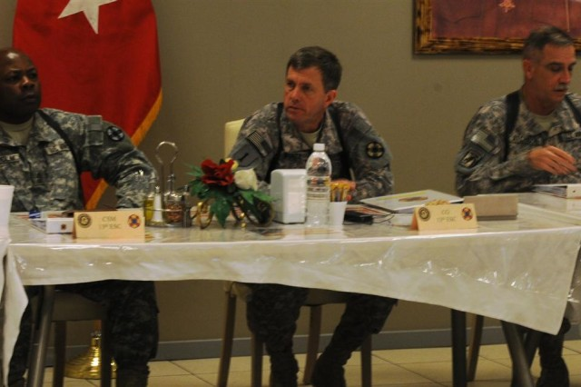 From left to right: Sgt. Maj. Oliver B. Chisolm, acting senior enlisted adviser for the 13th Sustainment Command (Expeditionary), Brig. Gen. Paul L. Wentz, commanding general with the 13th ESC, and Col. Knowles Atchison, deputy commander with the 13th ESC, listen to briefings given by a panel of key leaders at the rehearsal of concept drill at the Oasis Dining Facility Jan. 26 at Joint Base Balad, Iraq.