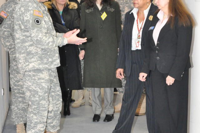 Gen. Carter Ham, U.S. Army Army Europe commander, talks with Cecilia Kandler, U.S. Army Garrison Wiesbaden Child, Youth and School Services director, and fellow CYSS staff members during a visit to the Wiesabaden Army Airfield Child Development Center Jan. 29. Ham and his wife, Christi, spent the day in Wiesbaden discussing Soldier and family quality-of-life issues and getting a look at transformation in the garrison.