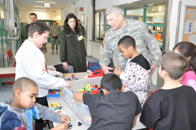 Gen. Carter Ham, U.S. Army Army Europe commander, and his wife, Christi, talk with children at the Wiesbaden Army Airfield School-Age Services Jan. 29. The commander and his wife spent the day in Wiesbaden discussing Soldier and family quality-of-life issues and getting a look at transformation in the garrison.