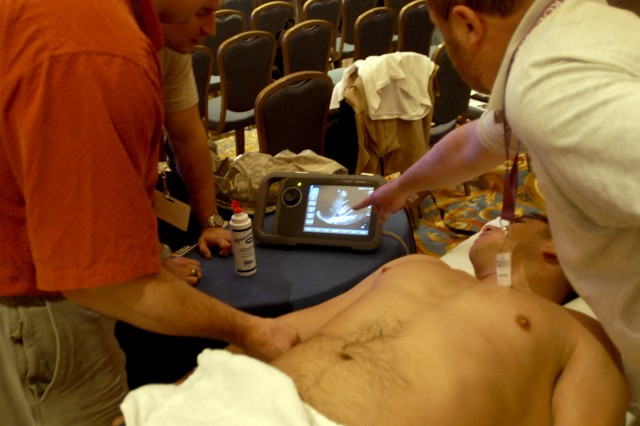 Clinicians attending the forum on portable ultrasound are given live views of the machine's capabilities during the Special Operations Medical Association annual conference Dec. 15, in Tampa, Fla. The all-day session involved practical training and lectures on the use of portable ultrasound.