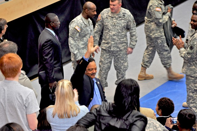 Rev. Jesse Jackson greets U.S. Army Garrison Wiesbaden community members during a visit to Wiesbaden Army Airfield Feb. 3 as past of Black History Month. Jackson noted the U.S. military's role in leading the nation in ending discrimination and offering equal opportunities to everyone.