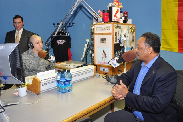 Air Force Staff Sgt. Tony Plyler interviews Rev. Jesse Jackson for the American Forces Network Radio (AFN Hessen -- the Eagle) during his visit to Wiesbaden Army Airfield as part of Black History Month activities Feb. 3. Station Manager Lon Blair (left) monitors the computer sound board.