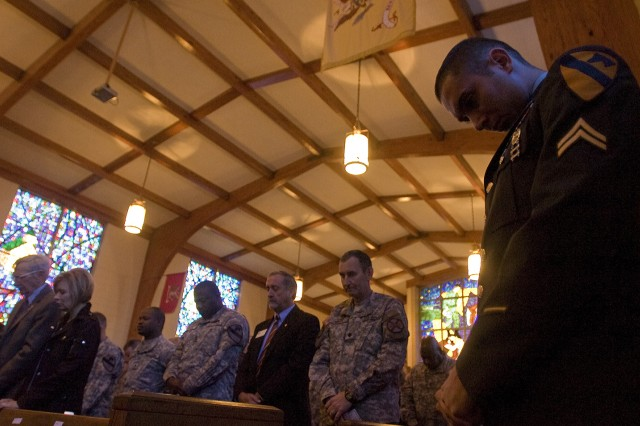 Cpl. David Haig, a team leader with the 1st Brigade Combat Team, 1st Cavalry Division lowers his head for prayer during a memorial service for two fallen Cavalry Soldiers, Sgt. David Andrew Croft, and Pvt. Jhanner Andres Tello, who were memorialized at Fort Hood Jan. 28.