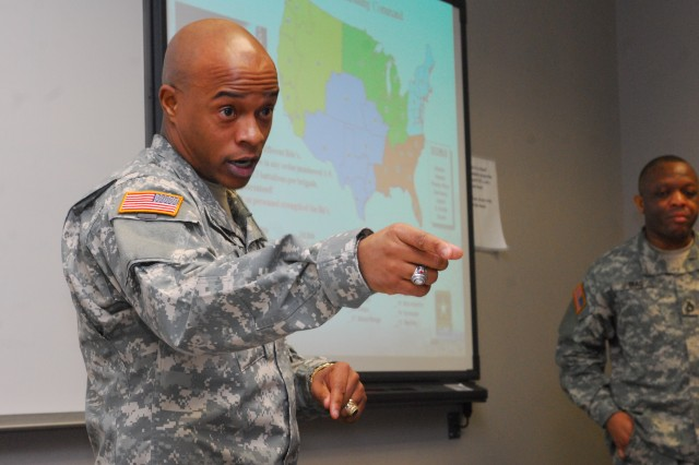 Sgt. 1st Class Marion Phinazee, United States Army Recruiting Command, Fort Knox, Ky., answers questions from potential recruiters at Fort Hood's Soldier Development Center Feb. 2.