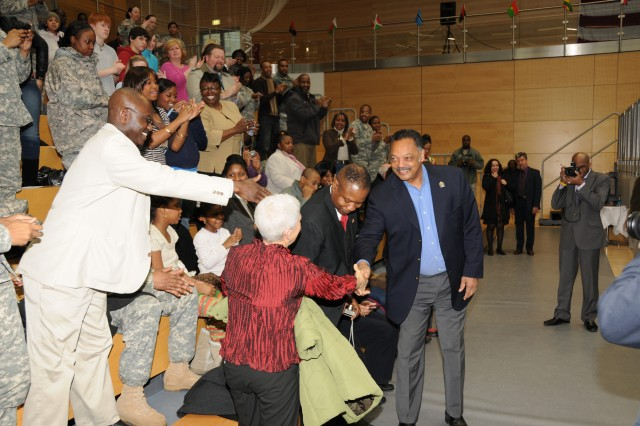 Rev. Jesse Jackson greets Wiesbaden military community members during his presentation at one of the garrison's Black History Month observance Feb. 3.