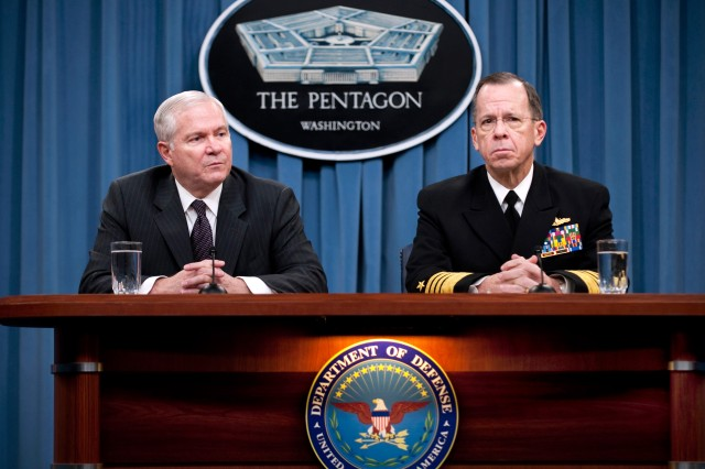 Defense Secretary Robert M. Gates and Navy Adm. Mike Mullen, chairman of the Joint Chiefs of Staff, brief the press on the Quadrennial Defense Review and the 2011 budget request at the Pentagon, Feb. 1, 2010.