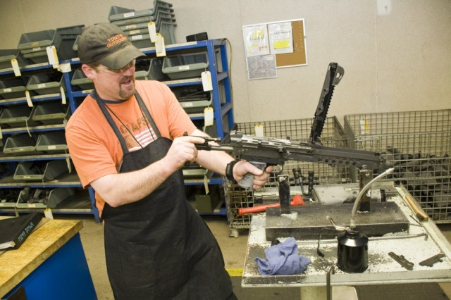Tony Morris builds a M249 Squat Automatic Weapon in the Small Arms Repair Facility at Anniston Army Depot.
