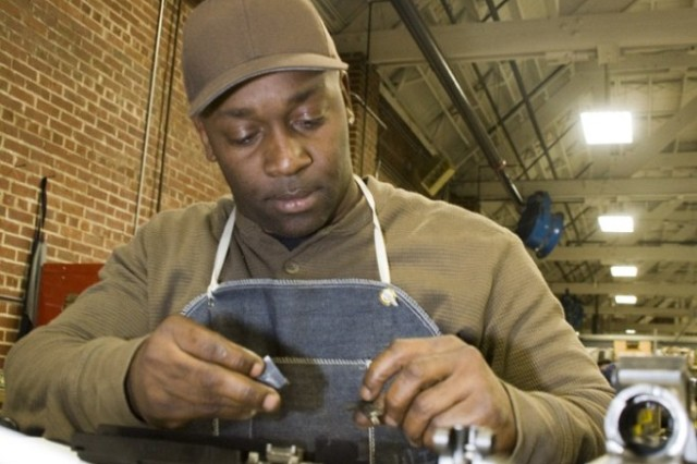 Detrick Wilson repairs a weapon in SARET - Repair Anniston's shop on Anniston Army Depot.
