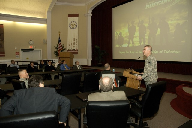 Research, Development and Engineering Command Chief of Staff Col. John Kilgallon (right) briefs 34 new civilian employees Feb. 4 at the Edgewood Conference Center. The Newcomer's Orientation provides new staff members with the overall mission and organization of the command.