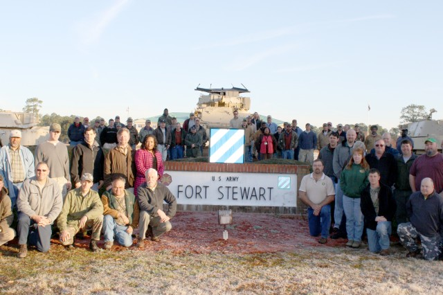 Fort Stewart-Hunter Army Airfield's Environmental Division of the Directorate of Public Works proudly poses for a group photo after winning the 2009 Military Installation Conservation Partner Award. Stewart-Hunter's Environment Division partners with the U.S. Fish and Wildlife Service, Georgia Department of Natural Resources, the Nature Conservancy and other conservation stakeholders to improve the longleaf pine ecosystem and recovery of the red-cockaded woodpecker and Indigo snake. The award will be officially presented next month in Milwaukee, Wis.
