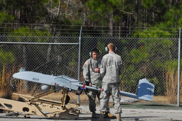 Sergeant Anthony Demaio and Spc. Kane Featherstone, both assigned to B Co., 4-3 BSTB, 4th IBCT, 3rd ID, prepare to launch the Shadow 200, a small tactical unmanned aerial vehicle, at Evans Army Airfield at Fort Stewart, Ga., in support of 3/7 Inf. training operations, Jan. 27.
