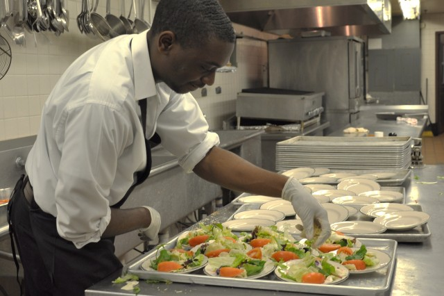Jesse Cavalier prepares salads for an event at the Sam Houston Club. This is his second term working at the club.