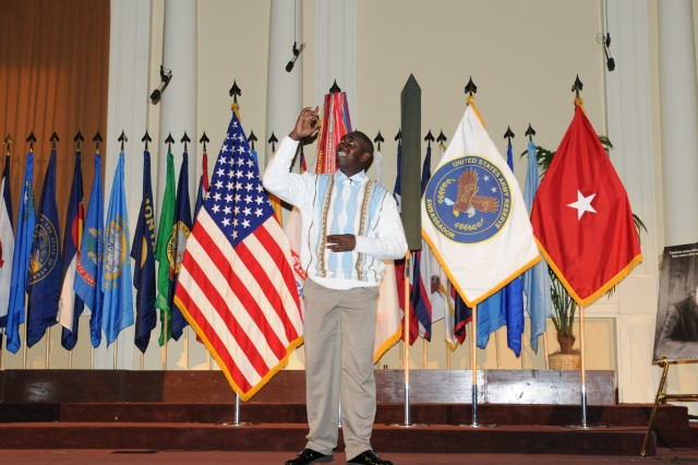 Specialist Euseke Rodgers, 92nd Engineer Battalion, recites an original poem during the cultural presentation in celebration of Martin Luther King, Jr. at the Main Post Chapel at Fort Stewart, Ga., Jan. 29.