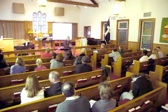 Chap. (Lt. Col.) Robert Phillips, U.S. Army Garrison chaplain (center), preaches at the first ChapelNext service Sunday. Forty three people attended the service. The ChapelNext service is held at the Main Post Chapel at Fort McPherson Sunday at 9:19 a.m.