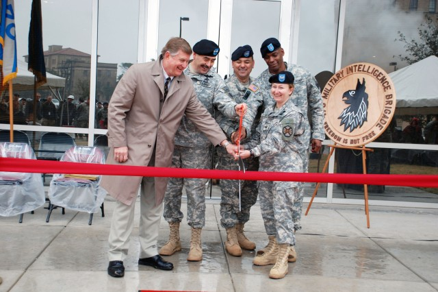 From left, Tom Chandler, chief executive officer, Orion Partners;  Maj. Gen. Simeon Trombitas, commanding general, U.S. Army South; Col. Jim Lee, 470th Military Intelligence Brigade commander; Command Sgt. Maj. Ronald Mason, 470th MI Brigade command sergeant major; and Col. Mary Garr, commander, U.S. Army Garrison, Fort Sam Houston, prepare to cut the ribbon officially opening Building 1070. The new building will serve as the headquarters for the brigade.