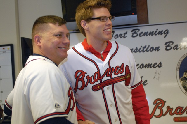 SFC Robert Nerkowski, A  Co., Warrior Transition Battalion, poses with baseball player Freddie Freeman Saturday at the Soldier and Family Assistance Center.