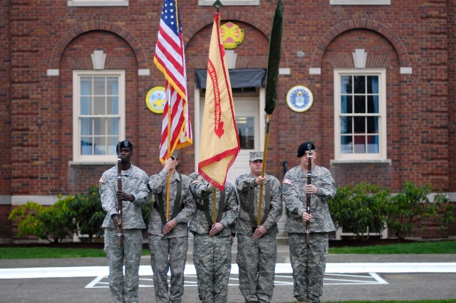 A joint color guard prepares for the Joint Base Lewis-McChord Initial Operational Capability ceremony in front of the JBLM headquarters building Monday.