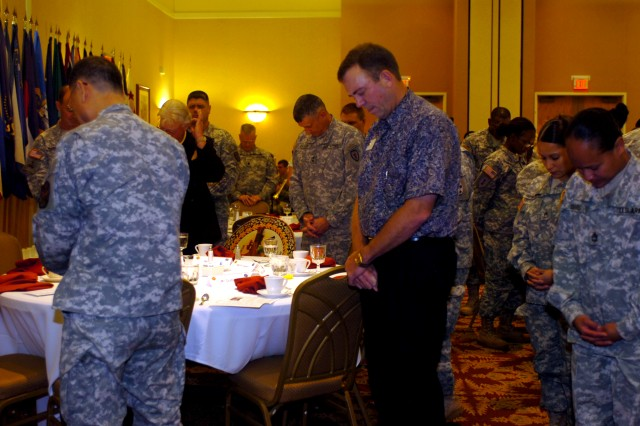 Soldiers and guests lower their heads in a moment of silence during the National Prayer Breakfast at the Nehelani Banquet and Conference Center at Schofield Barracks, Hawaii, Feb. 3. (U.S. Army photo by Spc. Mahlet S. Tesfaye, 25th Infantry Division Public Affairs Office.)