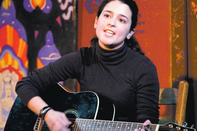 Caroline Garcia sings an original love song Friday at No Shame Theater.