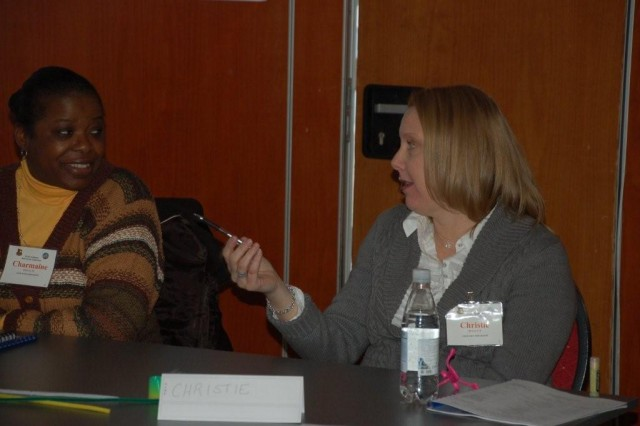 AFAP delegate, Christine Holloway (R) states her position while Charmaine Samuels listens with interest during USAG Schinnen's AFAP Conference, held Feb. 3 and 4. The two delegates were part of the single soldiers' work group that discussed AFAP issues unique to single military members.