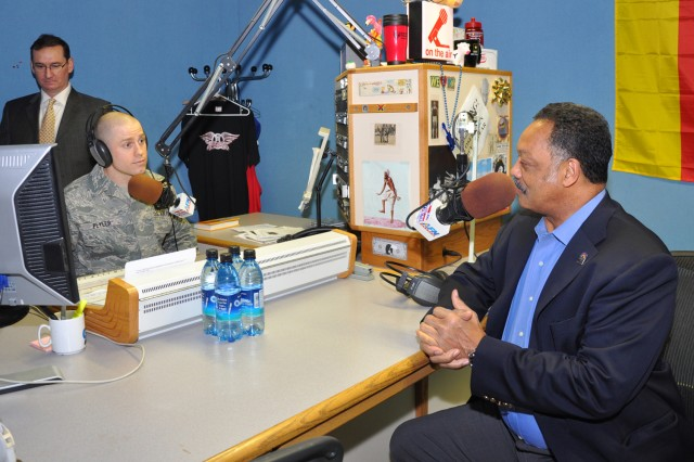 Air Force Staff Sgt. Tony Plyler interviews Rev. Jesse Jackson for AFN Hessen as Station Manager Lon Blair monitors sound during his visit to Wiesbaden Army Airfield as part of Black History Month activities Feb. 3.