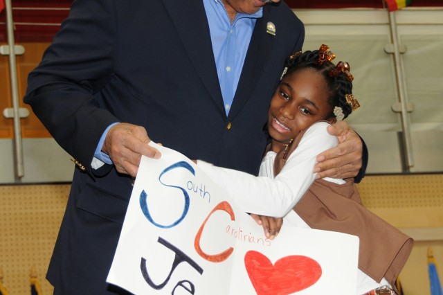 Rev. Jesse Jackson thanks Shoncire Graham, age 8, for a poster she presented him during his visit to U.S. Army Garrison Wiesbaden Feb. 3 as part of Black History Month.