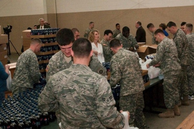 Fort Bragg volunteers pack Super Bowl care packages for Soldiers