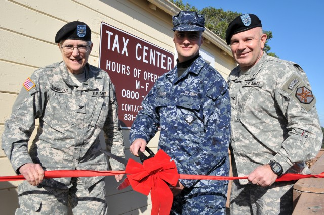 "PRESIDIO OF MONTEREY, Calif. -- The Presidio of Monterey Tax Center opens with a ceremonial ribbon cutting by Col. Sue Ann Sandusky (from left), Defense Language Institute Foreign Language Center commandant, Seaman Nathan Wade and Col. Darcy A. Brewer, POM garrison commander.   Wade was the first Presidio of Monterey service member to file his taxes using the free service. ""I am confident that ... service members, family and retirees who use the tax center will receive excellent service in a clean, professional environment and save themselves money because the service is absolutely free,"" Brewer said of the center."