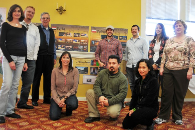 (Back row left to right) Elaine Koppany, Patrick Wilkes, Peter Silzer, Joshua Soto, Michael Cumberworth, Nikki Gagliardo, Dorice Farley, (Front row left to right) Nicole Phillips, Ramon Lomeli and Elizabeth Concepcion stand with one of the Technology Integration (TI) Division art displays at their Art Exposition.    Silzer, who is the only non-TI member, also volunteered some of his artwork to the exposition that he worked on during his free time away from the Student Learning Center.