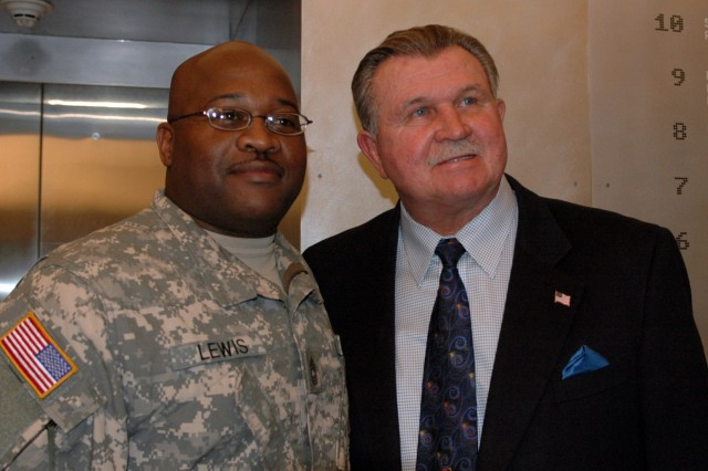 """A lot of people call us heroes but in our minds the men and women in uniform are the real heroes"", Mike Ditka, a former Dallas Cowboys player and coach, said as he spoke with Fort Hood Soldiers and posed for pictures before the taping of ""Glory Days"" scheduled to debut 30 Jan on CBS and air again 07 Feb before the Super Bowl. (U.S. Army photo by Cpl. Jessica Hampton, 15th Sustainment Brigade Public Affairs)"