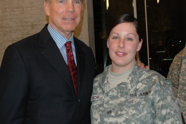 "Dallas, Texas - Sgt. Destony Troy, legal liaison and command finance specialist for the 15th Sustainment Brigade, a native of Odessa, Texas, poses with Roger Staubach, former Dallas Cowboys quarterback before the taping of ""Glory Days"" scheduled to debut 30 Jan on CBS and air again 07 Feb before the Super Bowl. (U.S. Army photo by Cpl. Jessica Hampton, 15th Sustainment Brigade Public Affairs)"