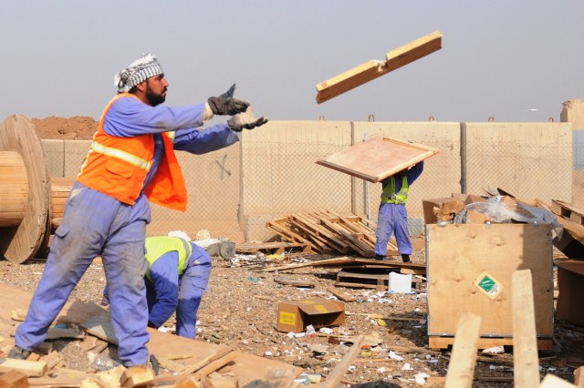 An Iraqi worker, contracted by the United Mandour Company, loads wood onto a truck Feb. 1 at the recycling yard at Joint Base Balad, Iraq. The pallets will be resold or reused in nearby villages. The jobs and supplies help boost the local economy and further the partnership between U.S. forces and the Iraqi people.