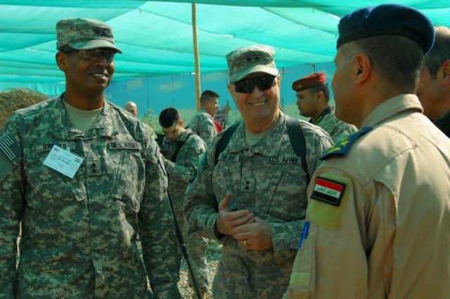Maj. Gen. Vincent Brooks, 1st Infantry Division commander, and Maj. Gen. Rick Nash, 34th Inf. Div. commander, talk with Brig. Gen. Sami Saeed, Iraqi Air Force 70th Squadron commander, at Contingency Operating Base Basra, Jan. 28, 2010.