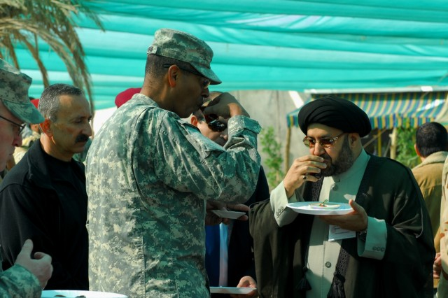 Maj. Gen. Vincent Brooks, 1st Infantry Division commander, drinks chai tea with Imam Sayid Abdul al-Moosawi, cleric for the al-Moosawi mosque in Basrah, at Contingency Operating Base Basra, Jan. 28, 2010.