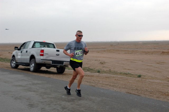 Staff Sgt. Roderick Reeves, 3rd Division Special Troops Battalion, 3rd Infantry Division, runs the 8.15-mile individual run as part of the Operation Iraqi Freedom Great Aloha Run (GAR) at Contingency Operating Base Speicher, near Tikrit, Iraq, Feb. 1. Staff Sgt. Reeves was the overall winner for the OIF GAR, finishing with a time of 47:26.  (Photo by: Sgt. 1st Class Tyrone C. Marshall Jr.  25th Combat Aviation Brigade Public Affairs)