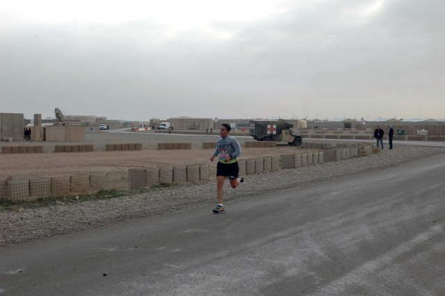 Sergeant First Class Silkia Ramos, 724th Transportation Company, 264th Combat Support Sustainment Battalion, nears the finish line after running the 8.15-mile individual run as part of the Operation Iraqi Freedom Great Aloha Run (GAR) at Contingency Operating Base Speicher, near Tikrit, Iraq, Feb. 1. Sergeant First Class Ramos was the overall female winner for the OIF GAR, finishing with a time of one hour, 10 seconds.  (Photo by: Sgt. 1st Class Tyrone C. Marshall Jr.  25th Combat Aviation Brigade Public Affairs)