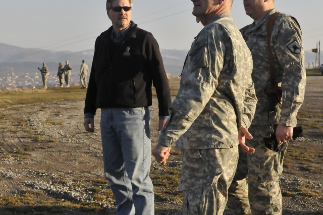 Gov. John Hoeven, Governor, North Dakota, Maj. Gen. David A. Sprynczaynatyk, Adjutant General, North Dakota National Guard, and Lt. Col. Lee Nordin, Grand Forks, N.D., battalion commander, 231st Maneuver Task Force, visit about the view at a memorial site overlooking Gnjilane/Gjilan, Kosovo.  Hoeven and Sprynczaynatyk both visited N.D. Soldiers while Rivera visited with Virgin Island Soldiers deployed to Camp Bondsteel, Kosovo for a Kosovo Forces (KFOR) 12 deployment.