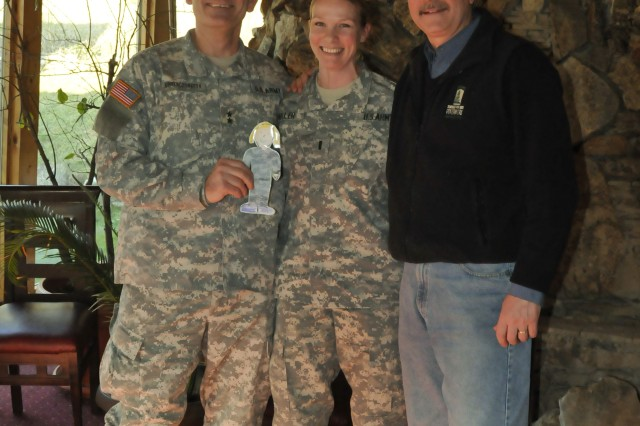 "Gov. John Hoeven, Governor, North Dakota, and Maj. Gen. David A. Sprynczaynatyk, Adjutant General, North Dakota National Guard, pose for a picture with 1st Lt. Kimberly Miller, Bismarck, N.D., a member of the 231st Maneuver Task Force, and her paper doll, ""Flat Stanley"" at a restaurant in Gnjilane/Gjilan, Kosovo.  ""Flat Stanley"", a paper doll sent to Miller by her second-grade niece, is a school project that was sent to loved ones to document his travels and adventures and then will be sent back to the student to share his stories with their classmates.  Hoeven and Sprynczaynatyk both visited N.D. Soldiers deployed to Camp Bondsteel, Kosovo for a Kosovo Forces (KFOR) 12 deployment."
