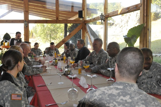 Gov. John Hoeven, Governor, North Dakota, and Maj. Gen. David A. Sprynczaynatyk, Adjutant General, North Dakota National Guard, visit with Soldiers during a lunch in Gnjilane/Gjilan, Kosovo.  Hoeven and Sprynczaynatyk both visited N.D. Soldiers deployed to Camp Bondsteel, Kosovo for a Kosovo Forces (KFOR) 12 deployment.