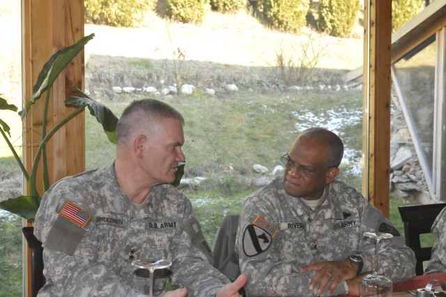 Maj. Gen. David A. Sprynczaynatyk, Adjutant General, North Dakota Army National Guard, visits with Brig. Gen. Renaldo Rivera, Adjutant General, Virgin Islands National Guard, during a lunch in Gnjilane/Gjilan, Kosovo.  Sprynczaynatyk and Rivera both visited their Soldiers deployed to Camp Bondsteel, Kosovo for a Kosovo Forces (KFOR) 12 deployment.