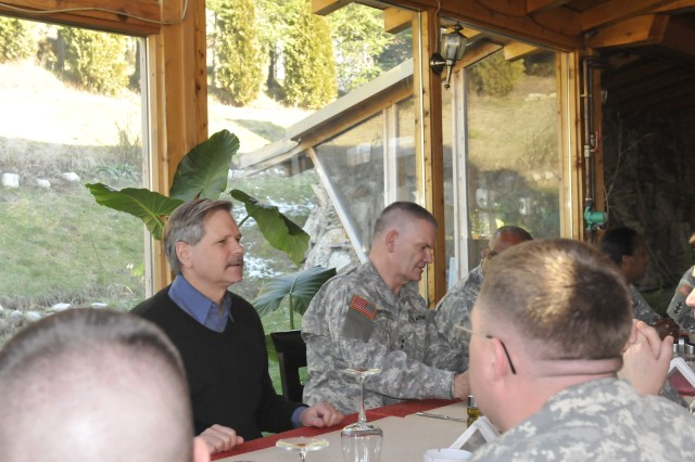 Gov. John Hoeven, Governor, North Dakota, and Maj. Gen. David A. Sprynczaynatyk, Adjutant General, North Dakota National Guard, visit with Soldiers during a lunch in Gnjilane/Gjilan, Kosovo.  Sprynczaynatyk and Hoeven both visited N.D. Soldiers deployed to Camp Bondsteel, Kosovo for a Kosovo Forces (KFOR) 12 deployment.