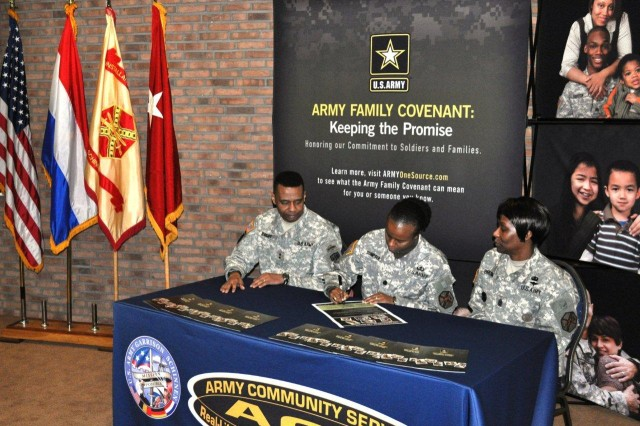 U.S. Army Lt. Col. Fern O. Sumpter signs the Army Family Covenant during a signing ceremony held Feb. 4 at the JFC Conference Center, Brunssum, Netherlands as Maj. Gen. Byron S. Bagby and Cmd. Sgt. Maj. Mary L. Brown observe. The ceremony rededicates tri-border leaders to the Army Family Covenant and the support of family readiness and support programs. Bagby, the Director of Operations at NATO's Joint Forces Command Headquarters in Brunssum is also the General Officer Senior Mission Commander for U.S. forces stationed in the Netherlands. Sumpter is the USAG Schinnen Garrison Commander. Brown is the USAG Schinnen Command Sergeant Major.