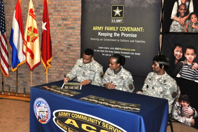 U.S. Army Maj. Gen. Byron S. Bagby signs the Army Family Covenant during a signing ceremony held Feb. 4 at the JFC Conference Center, Brunssum, Netherlands as Lt. Col. Fern O. Sumpter and Cmd. Sgt. Maj. Mary L. Brown observe. The ceremony rededicates tri-border leaders to the Army Family Covenant and the support of family readiness and support programs. Bagby, the Director of Operations at NATO's Joint Forces Command Headquarters in Brunssum is also the General Officer Senior Mission Commander for U.S. forces stationed in the Netherlands. Sumpter is the USAG Schinnen Garrison Commander. Brown is the USAG Schinnen Command Sergeant Major.